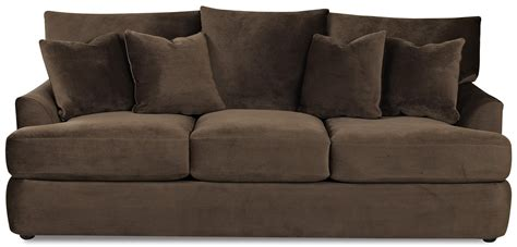placing pictures above sofa elliston place findley three three sofa with accent