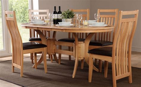 oval dining room tables and chairs townhouse oval extending dining table and 4 bali chairs set