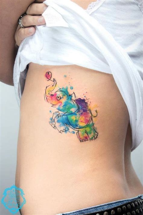 watercolor tattoo ribs elephant with watercolor on rib side