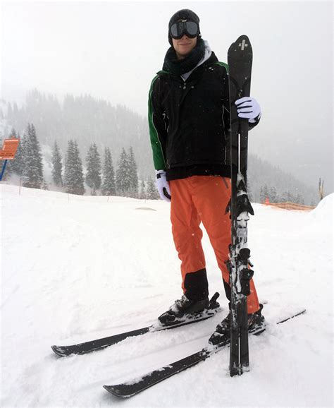 designboom editor testing handcrafted zai skis on the slopes of disentis