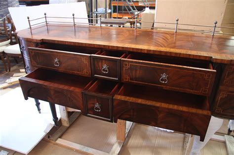 mahogany dining room sideboard with antiqued brass accents