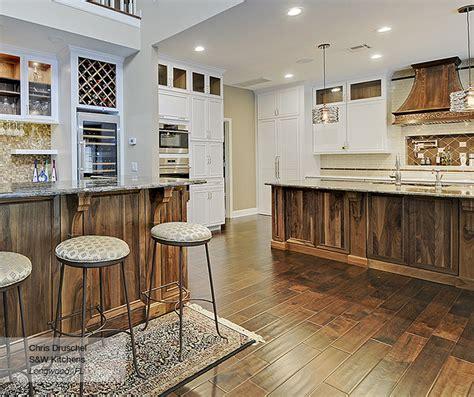 natural walnut kitchen cabinets white cabinets with a walnut kitchen island masterbrand