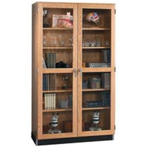 oak storage cabinet with doors wall storage cabinet with oak framed glass doors 36 quot w