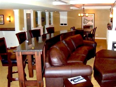 tall table behind couch basement design leather couch with a custom bar height