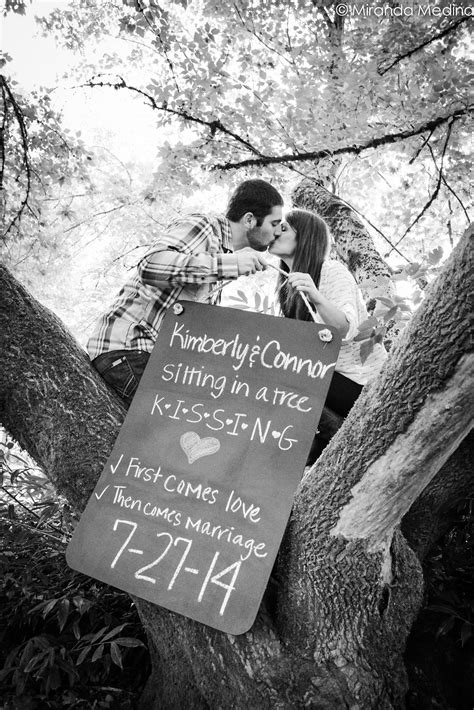 Kissing in a tree save the date idea. (With images