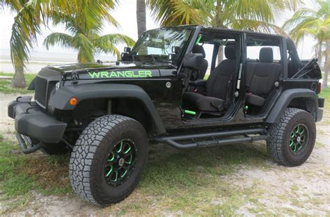dark green jeep lifted our jeeps