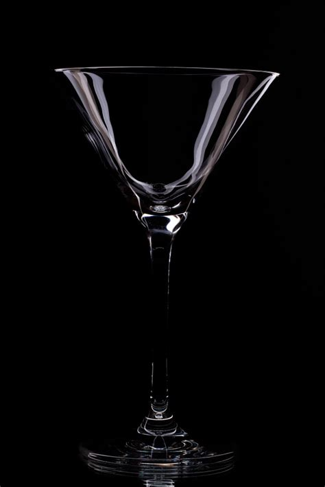 martini glass background glass in a black background photo free
