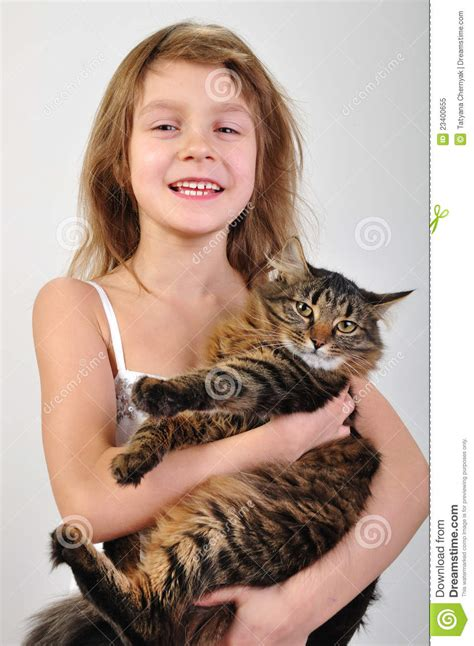 cat child happy child holding a cat in stock image image
