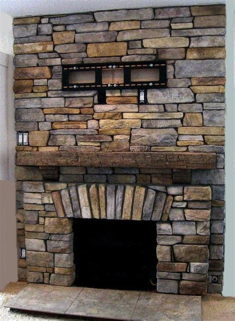 stacked fireplace and rustic wood mantle you