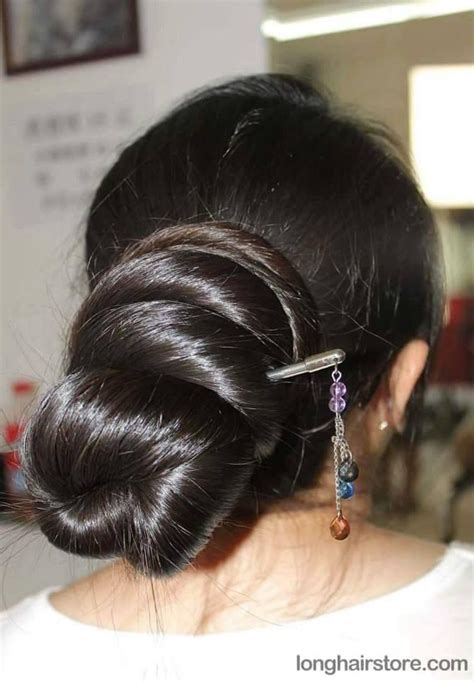 long hair that comes to a point what a beautiful large low bun care however should be