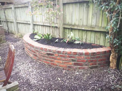 Planter Retaining Wall by Reclaimed Brick Planter Retaining Wall Blue Slate Path