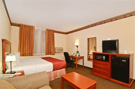 standard room amenities accommodations hotel rooms paradise inn suites ab