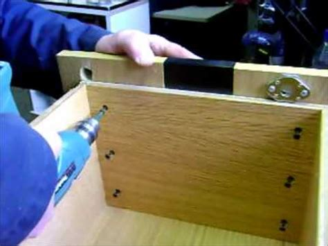 How To Put A Lock On A Drawer by Install Simple Swing Lock In Bottom Drawer Of Wood