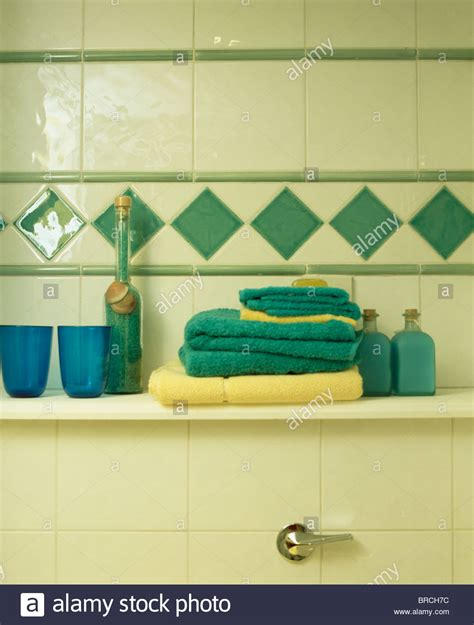 turquoise and yellow bathroom close up of turquoise and yellow towels on bathroom shelf