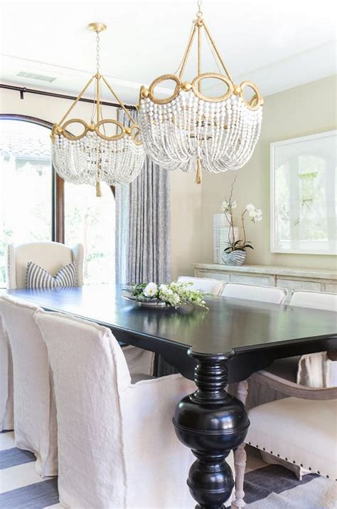 chandelier over table two chandeliers above table dining room and those