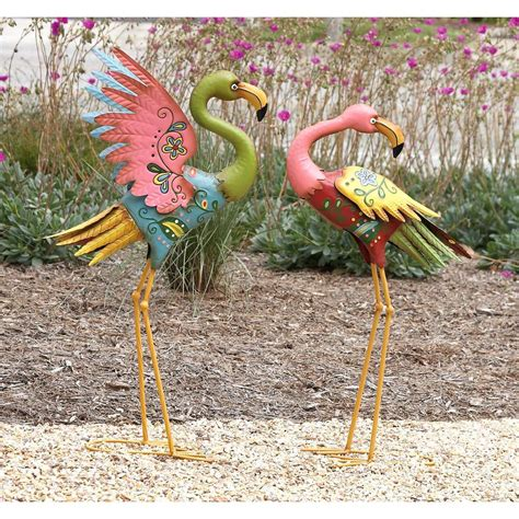 american home metal flamingo sculptures in pastel colors