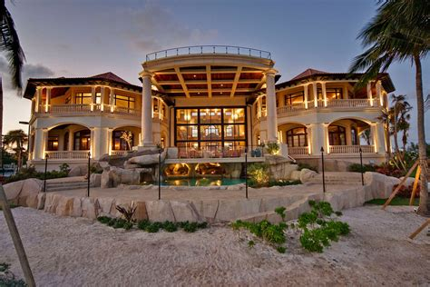 Tuscan Home Designs grand cayman luxury home with grotto pools idesignarch