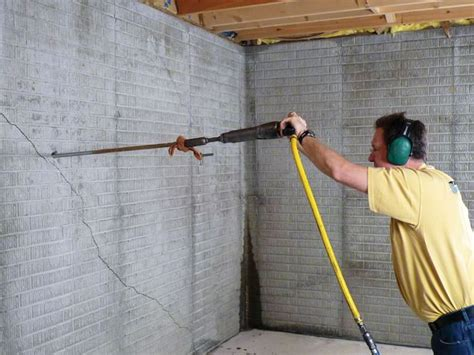 how to fix a in basement wall repairing straightening tilting foundation walls by