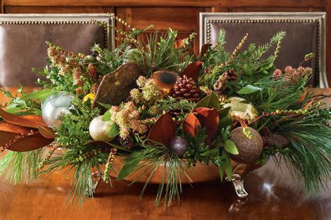 100 fresh christmas decorating ideas southern living create an evergreen centerpiece 100 fresh christmas