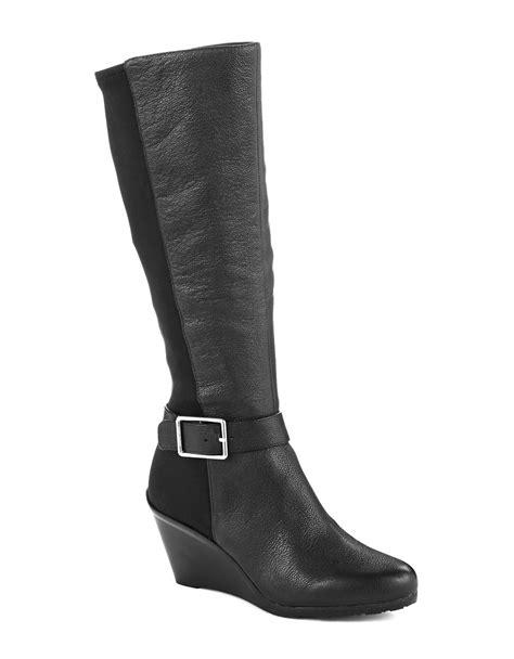 calvin klein boots calvin klein taya knee high boots in black lyst