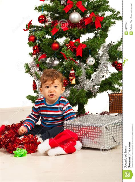 funny kid under christmas tree stock photo image 34263562