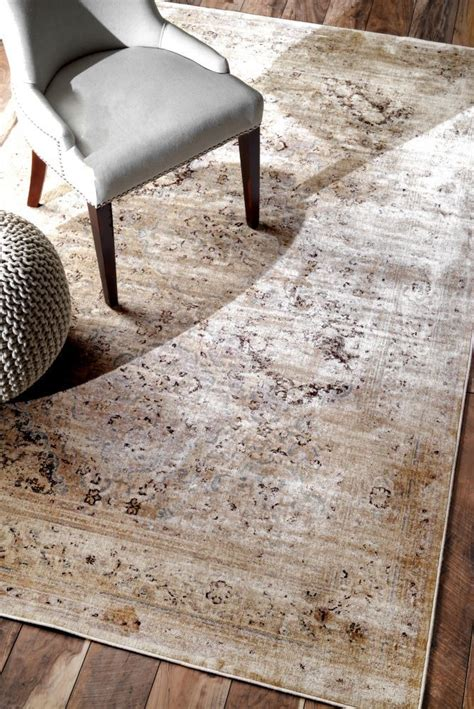 Choosing Area Rugs Design Tip How To Choose The Area Rug More Traditional Area Rugs And Taupe Ideas