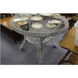 white wicker dining table with glass top