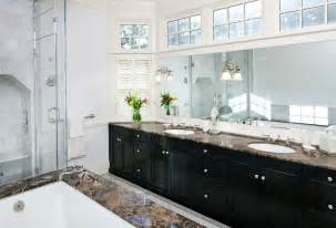 Clerestory framed windows in this bathroom enable a mirror to be