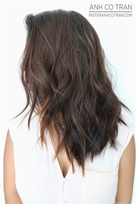 GORGEOUS LAYERS WITH A SOFT UNDERCUT. Cut/Style: Anh Co Tran. Appointment inquiries please call