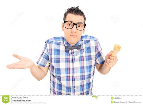 man holding ice cream cone sad man holding an empty ice cream cone stock photo