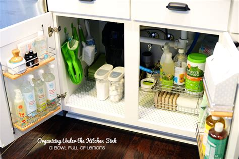 under kitchen sink storage ideas organizing under the kitchen sink a bowl full of lemons