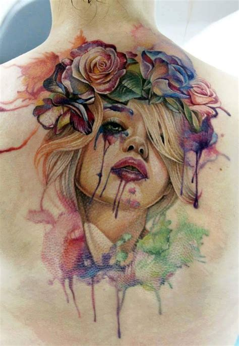 watercolor tattoo upper back color flowers and garter lace on thigh