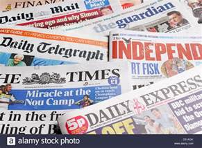 Paper From Newspaper - uk newspapers broadsheet daily newspapers stock photo