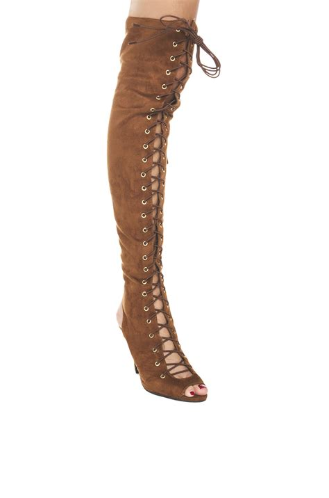 thigh high heeled lace up boots in brown lyst