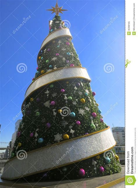 big christmas tree with round thing editorial image