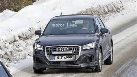 audi sq spied   camouflage