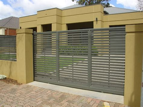 yellow exterior color ideas with modern iron fence and