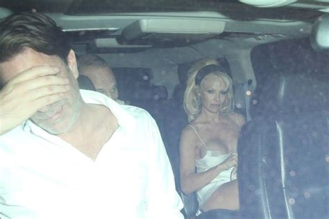 pamela wardrobe malfunction pamela anderson suffers nip slip in barely there strappy dress after night out at chateau
