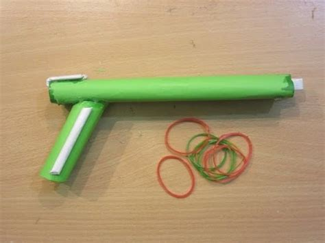 How To Make A Paper Rubber Band Gun - how to make a paper gun that shoots 2 rubber bands easy