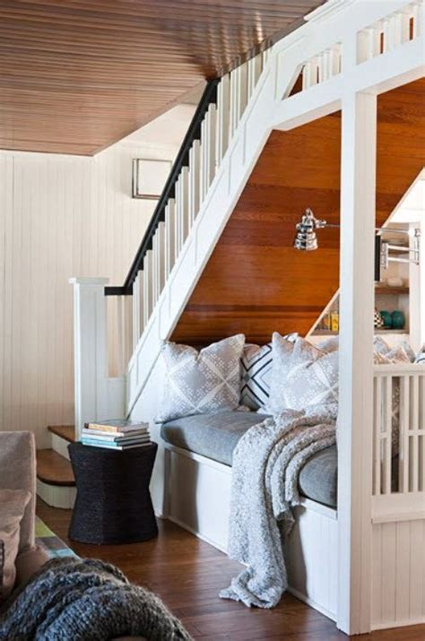 reading seating nook tucked under stair iop pinterest