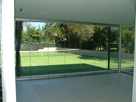 frameless bifold doors precision glass glazing across