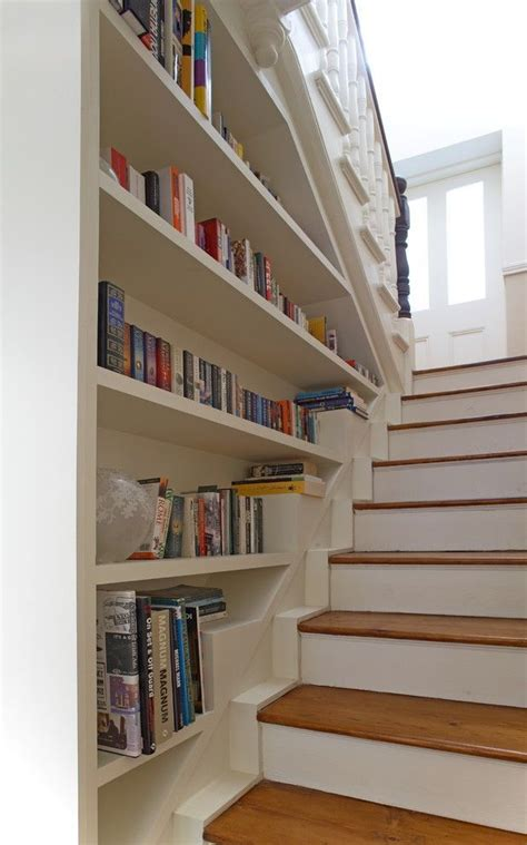bookcase built into stair wall entry way stairs