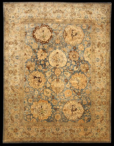 tabriz antique rug the abrashed blue field with a cloud