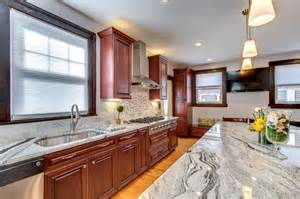 Over Island Lighting In Kitchen viscont white granite countertops with cherry cabinets