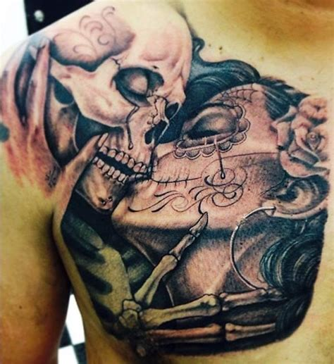 kiss tattoo on chest meaning kissing skull tattoo on man chest