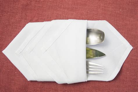 How To Fold Paper Napkins Into Shapes - how to fold cutlery into a napkin our everyday