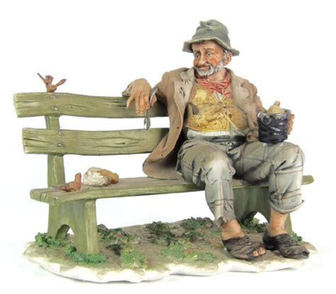 capodimonte man on bench a capidomonte porcelain figure of an old man seated on a
