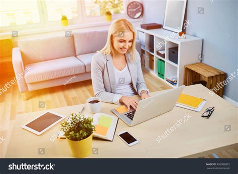 running a small business from home happy running small business stock photo