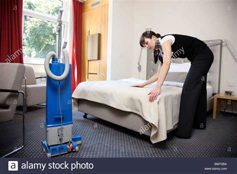 Room Cleaning by Hotel Room Service House Keeping At Work In A Hotel Room