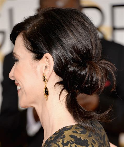 julianna margulies new hair cut julianna margulies chignon updos lookbook stylebistro